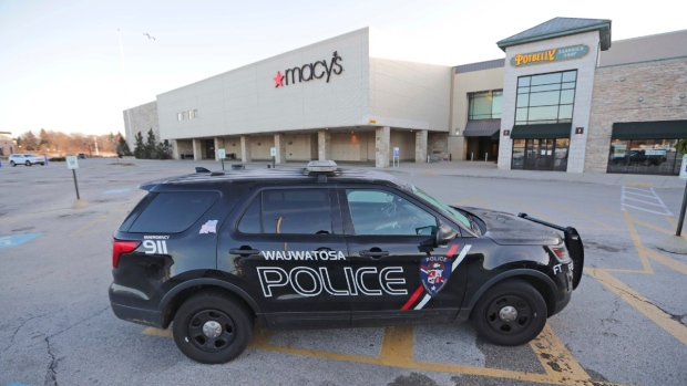 A Wauwatosa police vehicle sits outside Macy's near the entrance to Mayfair Mall in Wauwatosa, Wis., on Nov. 21, 2020. (Mike De Sisti / Milwaukee Journal-Sentinel via AP)