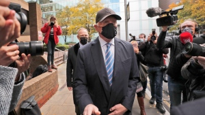 Boris Becker leaves Southwark Crown Court in London, Thursday, Oct. 22, 2020. German tennis star Boris Becker was charged in October with 19 offences of failing to disclose money and property as part of bankruptcy proceedings. (AP Photo/Frank Augstein)