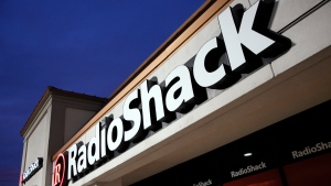This Tuesday, Feb. 3, 2015 file photo shows a RadioShack store in Dallas. RadioShack, the nearly century-old electronics retailer ubiquitous in malls for decades, has been pulled from brink of death — again. It's the most prized name in the basket of retail brands that entrepreneur investors Alex Mehr and Tai Lopez have scooped up for a relative pittance since the coronavirus pandemic landed on U.S. shores. (AP Photo/Tony Gutierrez, File)