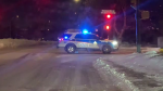 A Saskatoon Police Service cruiser blocks traffic in the city's Fairhaven neighbourhood on Tuesday night. (Matt Young/CTV)