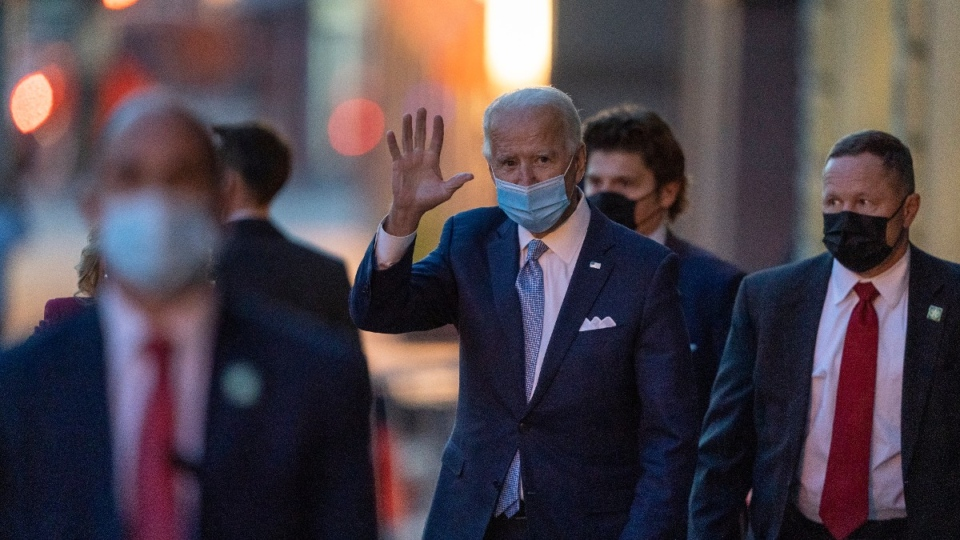 U.S. president-elect Joe Biden waves as he leaves The Queen theatre in Wilmington, Del., on Nov. 24, 2020. (Carolyn Kaster / AP)