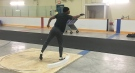 Olympian Damian Warner releases shot put as he trains in London, Ont. on Tuesday, Nov. 24, 2020. (Brent Lale / CTV News)