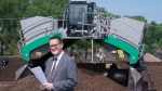 The Green Fund reports to Quebec Environment Minister Benoit Charette, seen next to a compost turner during a news conference in Montreal on Friday, July 3, 2020. The fund continues to be mismanaged according to a new report. THE CANADIAN PRESS/Paul Chiasson