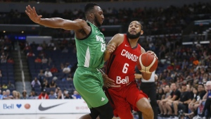 Canada's Cory Joseph (6) works his way around Nigeria's Josh Okogie (20) on his way to the net during the first half of their exhibition game in Winnipeg, Friday, August 9, 2019. THE CANADIAN PRESS/John Woods