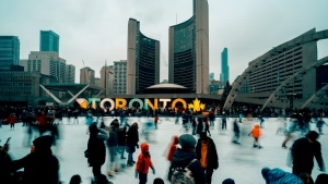 Toronto residents and visitors skating at Toronto residents and visitors skating at Nathan Phillips Square, one of the city's most popular rinks. (Pexels)