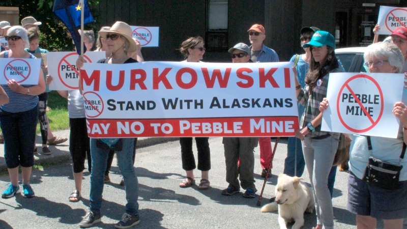 In this June 25, 2019 file photo, people gather outside U.S. Sen. Lisa Murkowski's office in Juneau, Alaska, to protest the proposed Pebble Mine. (AP Photo/Becky Bohrer, File)