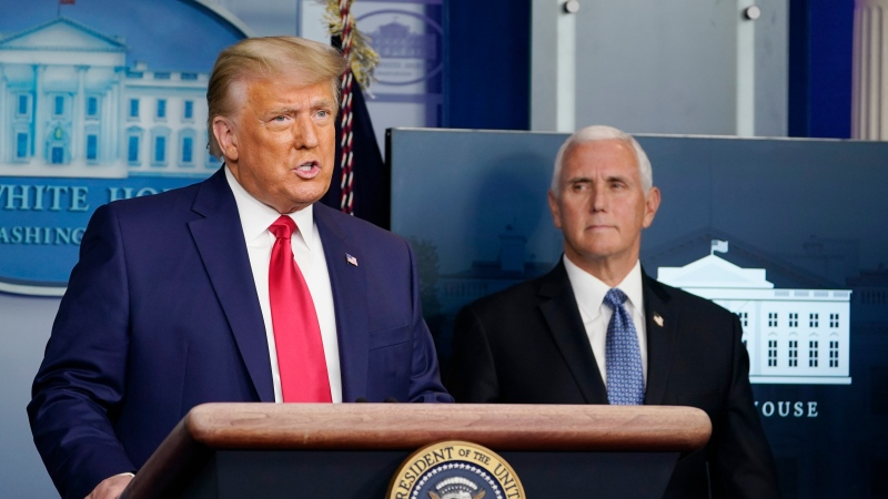 U.S. President Donald Trump speaks in the Brady Briefing Room in the White House, Tuesday, Nov. 24, 2020, in Washington as Vice President Mike Pence looks on. (AP Photo/Susan Walsh)