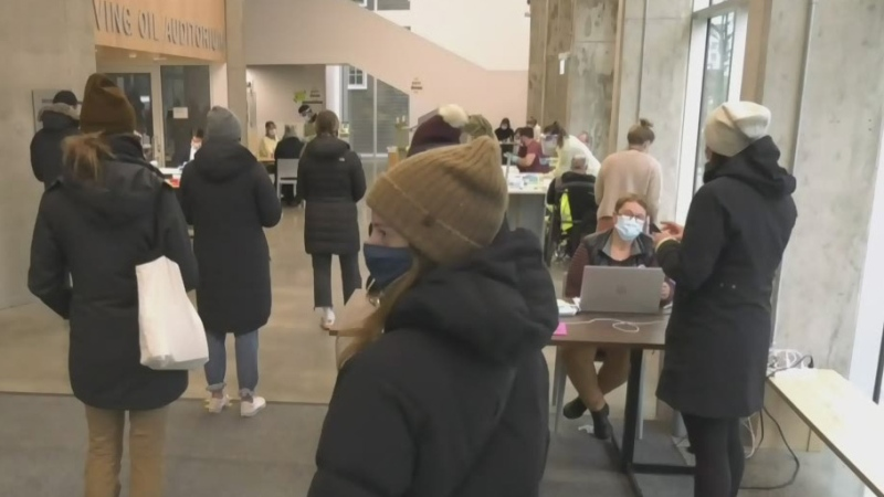 The queue for rapid COVID-19 testing in Halifax started early on Wednesday morning. By early afternoon, the lineup stretched a full city block and then some.