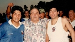 Diego Maradona, right, poses for a photo with Toronto Italia owner Pasquale Fioccola, centre, and brother Lalo Maradona after playing for Toronto Italia in an exhibition game against the Canadian National Soccer League all-stars at Birchmount Stadium in Toronto on Sept. 2, 1996. (THE CANADIAN PRESS/HO - Fioccola Family)