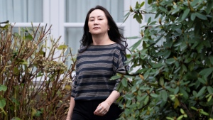 Chief Financial Officer of Huawei Meng Wanzhou leaves her home in Vancouver, Wednesday, Nov. 25, 2020. (Jonathan Hayward / THE CANADIAN PRESS)