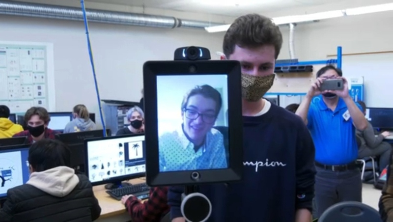 Cody Kirk (in monitor) returns to his grade 12 at Notre Dame high school class via a robot. Kirk has Gaucher disease, which causes internal organs to swell