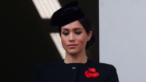 FILE - In this Nov. 11, 2018 file photo, Meghan Markle, Duchess of Sussex, attends the Remembrance Sunday ceremony at the Cenotaph in London. Meghan Markle's father appealed to his daughter to call him, saying on Monday, Dec. 17, 2018, that they hadn't been in touch since her wedding to Prince Harry in May. (AP Photo/Alastair Grant, File)