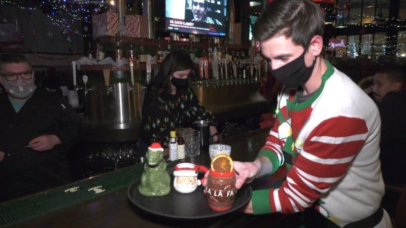 A server grabs some of the holiday libations available at the Miracle cocktail bar pop-up. Nov. 25, 2020. (CTV News Edmonton)