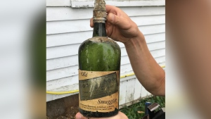 Nick Drummond and Patrick Bakker said they found more than 66 bottles of whiskey from the Prohibition-era hidden within the walls and floorboards of their home. (Nick Drummond)