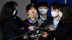 "In this March 25, 2020, file photo, Cho Ju-bin, centre, leader of South Korea's online sexual blackmail ring which is so called ""Nth room,"" is surrounded by journalists while walking out of a police station as he is transferred to prosecutors' office for further investigation in Seoul, South Korea. (Kim Hong-Ji/Pool Photo via AP, File)"