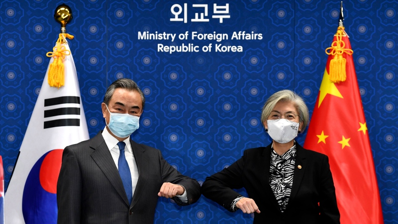 Chinese Foreign Minister Wang Yi, left, and South Korean Foreign Minister Kang Kyung-wha, right, pose together prior their meeting at the foreign ministry in Seoul, South Korea, Thursday, Nov. 26, 2020. (Kim Min-hee/Pool Photo via AP)