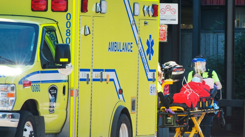 A resident is transported to an ambulance by first responders at the CHSLD Lasalle as new daily COVID-19 cases in Quebec remain over 1,000, Friday, October 9, 2020 in Montreal.THE CANADIAN PRESS/Ryan Remiorz