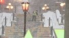 A worker clears snow from steps near York Street and Sussex Drive on Wednesday, Nov. 25. (Jim O'Grady/CTV News Ottawa)