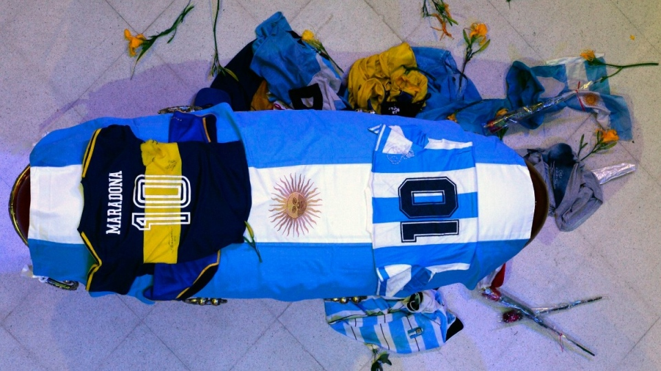 The coffin with the remains of Diego Maradona lies in state inside the presidential palace in Buenos Aires, Argentina, on Nov. 26, 2020. (Argentina's Presidency via AP)