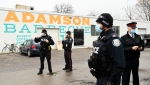 Police officers monitor the situation at Adamson Barbecue as the restaurant has defied provincial lockdown orders to shut down indoor and outdoor dining during the COVID-19 pandemic in Toronto on Wednesday, November 25, 2020. THE CANADIAN PRESS/Nathan Denette