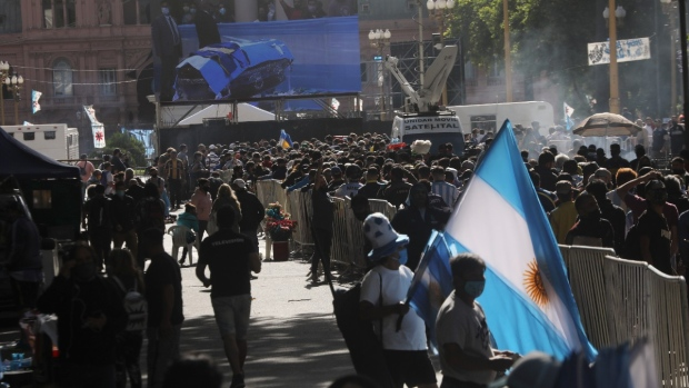 Mourners line-up to see Diego Maradona lying in state outside the presidential palace in Buenos Aires, Argentina, Thursday, Nov. 26, 2020. (Rodrigo Abd / AP)
