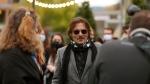 Johnny Depp, centre, arrives at the 16th Zurich Film Festival (ZFF) in Zurich, Switzerland, on Oct. 2, 2020. (Alexandra Wey / Keystone via AP)