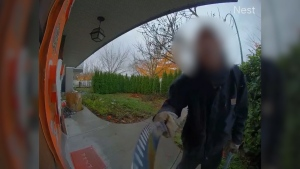 A man with a knife was spotted in the security camera at an East Vancouver home. (Submitted)