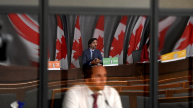 Prime Minister Justin Trudeau is seen reflected in the plexiglass of a translator's booth during a news conference on the COVID-19 pandemic on Parliament Hill in Ottawa, on Friday, Sept. 25, 2020. THE CANADIAN PRESS/Justin Tang