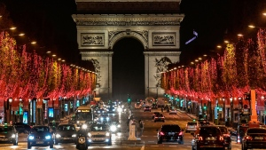 The Champs-Elysees Avenue and the Arc de Triomphe in Paris with Christmas lights on November 22, 2020. (Stephane de Sakutin/AFP/Getty Images)