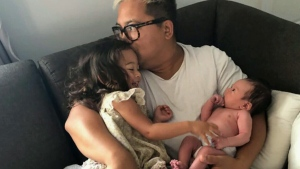 Rex De Castro holds his two children, Beatrix and Boston. Boston was diagnosed with a rare and life- threatening disease, but he needs a stem cell transplant from a half-Filipino and half-Caucasian donor.