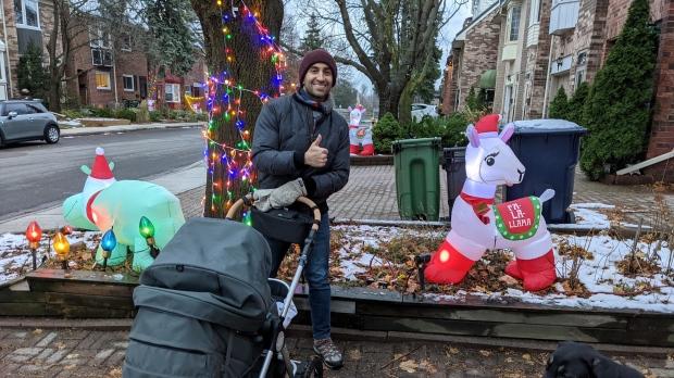 Raffi DerGhazarian is seen beside an inflatable holiday-themed llama. (Photo provided by DerGhazarian)