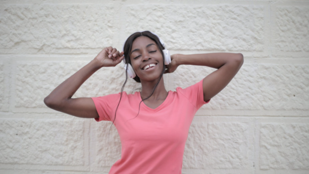 A woman listens to music in this stock image. (Pexels)