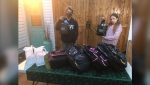 15-year-old Dylan van Dusen and 13-year-old Quiryanna Nuttall are filling backpacks for the homeless in Kingston. (Kimberley Johnson/CTV News Ottawa)