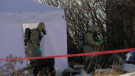 Emergency personnel in hazmat suits exit a tent at a property near the hamlet of Delacour, Alta. on Nov. 25 as part of a criminal investigation into suspected drug activity