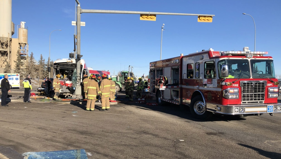 The crash, at 52 St. and 90 Ave. S.E., involved a transit bus and a semi truck.