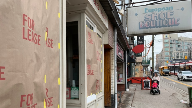 """A storefront on Roncesvalles Avenue displays a """"for lease"""" sign as part of a protest against the Ontario government's pandemic lockdown rules in Toronto on Tuesday Nov. 24, 2020. THE CANADIAN PRESS/Jody White"""