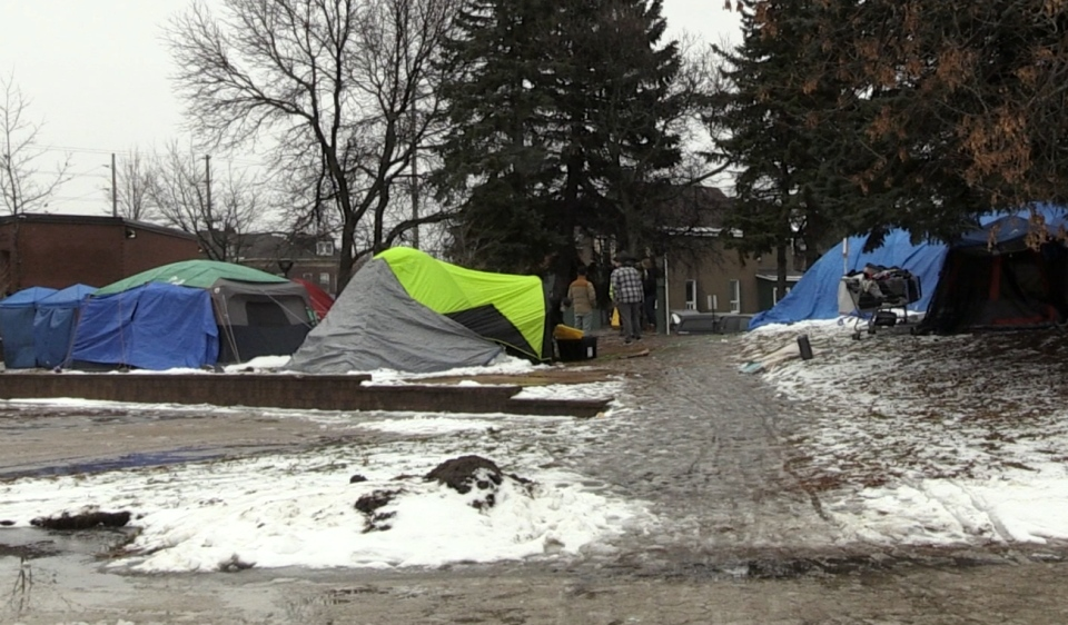 Residents who have been camping outside North Bay's city hall got an eviction notice Thursday morning, with city bylaw officials moving in at 2 p.m. to dismantle the makeshift camp. (Alana Pickrell/CTV News)