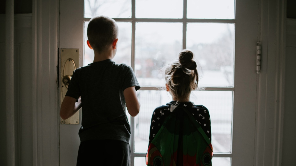 Kids looking outside during a pandemic quarantine