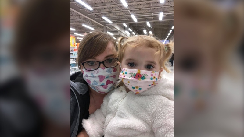 Cari-Lynn Thiessen and her daughter Hallie are pictured in an undated photo. The pair were recently diagnosed with COVID-19, and Cari-Lynn is worried her daughter will feel worse effects due to her rare condition. (Source: Cari-Lynn Thiessen)