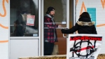 Adam Skelly, left, owner of Adamson Barbecue defies provincial lockdown orders to shut down indoor and outdoor dining during the COVID-19 pandemic in Toronto on Wednesday, November 25, 2020. THE CANADIAN PRESS/Nathan Denette