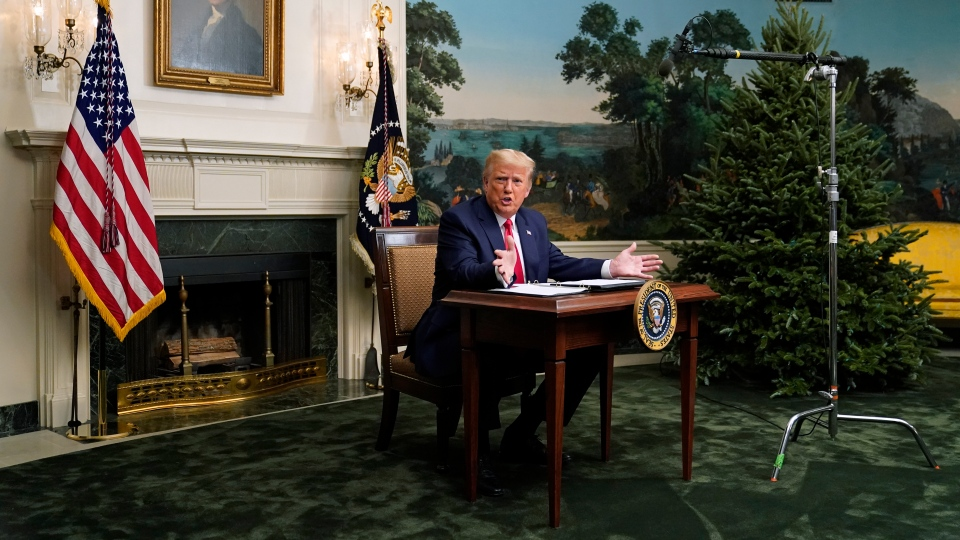U.S. President Donald Trump speaks with reporters after participating in a video teleconference call with members of the military on Thanksgiving, Thursday, Nov. 26, 2020, at the White House in Washington. (AP Photo/Patrick Semansky)