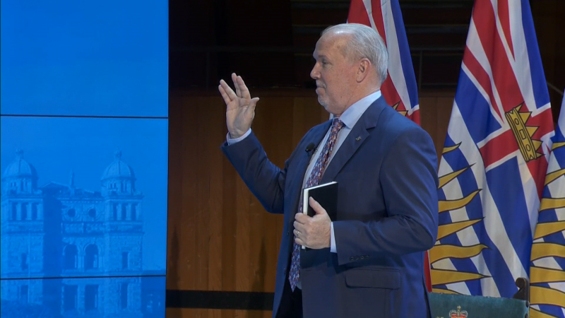 John Horgan gives a Vulcan salute while being sworn in as B.C's 36th premier on Nov. 26, 2020.