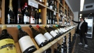 In this Feb. 29, 2012, file photo a shopper looks over the wine at King & Godfree, one of Australia's oldest licensed grocery stores in, Melbourne, Australia. (AP Photo/Mal Fairclough, FILE)