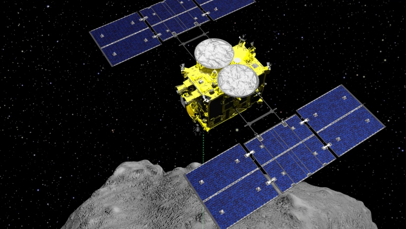 This computer graphics image released by the Japan Aerospace Exploration Agency (JAXA) shows the Hayabusa2 spacecraft above the asteroid Ryugu. (ISAS/JAXA via AP, File)