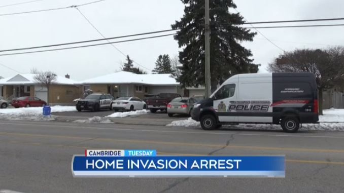 Regional police have arrested two men in connection to a home invasion in Cambridge that left two people hurt.