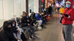 The sneaker store on Ste. Catherine Street in Montreal drew line ups despite the ugly weather and, more significantly, the second wave of the COVID-19 pandemic. (Cosmo Santamaria/CTV News)