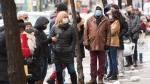 People line up at a store in Montreal, on Nov. 23, 2020. (Ryan Remiorz / THE CANADIAN PRESS)