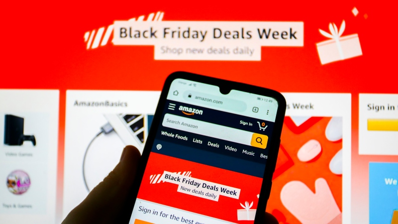Black Friday deals of Amazon online store are displayed on a mobile phone on the eve of Black Friday Day in Krakow, Poland on November 26, 2020. (Photo by Beata Zawrzel/NurPhoto via Getty Images)