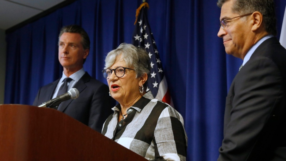 Mary Nichols, centre, flanked by Calif. Gov. Gavin Newsom, left, and Calif. Attorney General Xavier Becerra, right, in Sacramento, Calif., on Sept. 18, 2019. (Rich Pedroncelli / AP)
