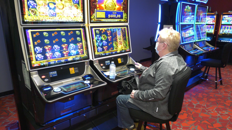 Irene Mclaren at one of Bingoland Gaming Centre's new slot-style games. (Shaun Vardon/CTV News Ottawa)